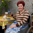 Royalty-Free Stock Photo: The woman-invalid drinks tea