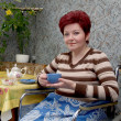 Постер, плакат: The woman invalid drinks tea