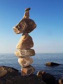 Cairn on blue sky background. — Stock Photo