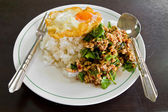 Cooked rice with spicy minced meat salad — Stock Photo
