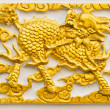 Golden dragon-headed unicorn craft on wall — Stock Photo