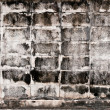 Aged gray rectangle brick wall — Stock Photo