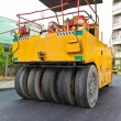 Stock Photo: Steamroller on asphalt road from back