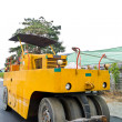 Stock Photo: Steamroller on asphalt road from front