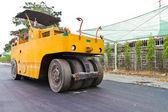 Steamroller on asphalt road — Стоковое фото