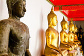 Black Buddha statue among other golden — Stock Photo
