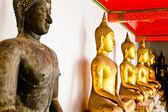 Black Buddha statue among other golden — Stock Photo