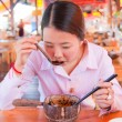 Asian woman eating noodle — Stock Photo #9147751