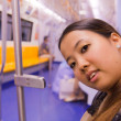Asian woman on train — Stock Photo #9183255