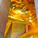 Face of reclining Buddha statue — Stock Photo #9302256