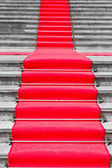 Red carpet way on black and white staircase — Stok fotoğraf