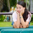 Distracted woman in park — Stock Photo