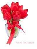 Red tulips in glass jar — Stock Photo