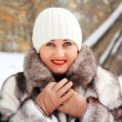 Stock Photo: Beautiful young woman in winter coat