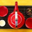 Red tea pot on black tray — Stock Photo