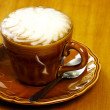 Cafe latte on brown plate - Stock Photo