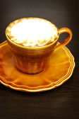 Cafe Latte with brown plate — Stock Photo