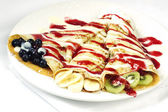 Rolled french crepes with blueberry banana and kiwi — Stock Photo