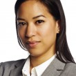Mature asian business woman looking at camera on white — Stock Photo