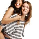 Young woman enjoying a piggyback ride — Stock Photo