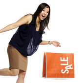 Asian business woman holding shopping bag — Stock Photo