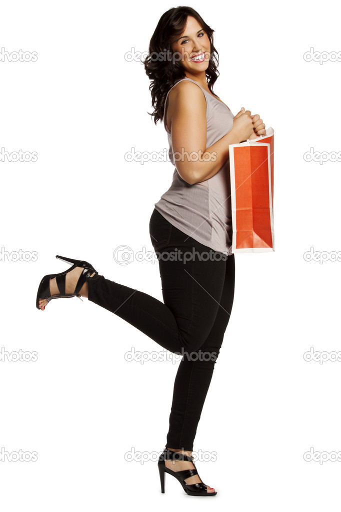 Full length portrait of excited casual woman holding shopping bag on white background — Stock Photo #9277560