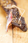 Biltong - dry cured beef meat , with slice — Stock Photo