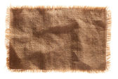 Very detailed hi res photo of a burlap canvas isolated with lace — Stock Photo