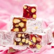 Turkish delight with pistachios nut in glitter pink and rose pe - Stock Photo