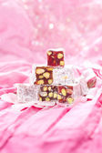 Turkish delight with pistachios nut in glitter pink and rose pe — Stock Photo