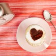 Stock Photo: Cappuccino with heart, red stripy backdrop