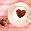 Cappuccino with heart, red stripy backdrop — Stock Photo