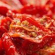 Sun-dried tomatoes with olive oil, background, shallow dof — Stock Photo