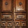 Stock Photo: Very old wooden doors