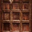 Old ornamental wooden carved door — Stock Photo