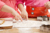 Little girls baking and having fun, hands only — Stock Photo