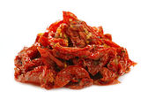 Sun-dried tomatoes with olive oil, isolated on white — Stock Photo