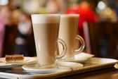 Coffee latte in two tall glasses — Stock Photo