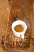 Espresso coffee in thick white cup on old wooden bench — ストック写真