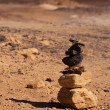 Stacked stones in Black Desert in Sahara, western Egypt - Stock Photo