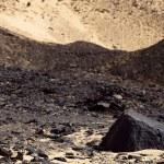 Basalt stone in Black Desert in Sahara, western Egypt — Stock Photo #9664459