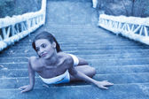 Fabulous woman lying on icy stairs — Stock Photo