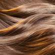 Royalty-Free Stock Photo: Beautiful healthy shiny hair texture with highlighted golden str