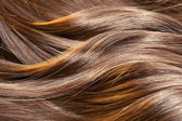 Beautiful healthy shiny hair texture with highlighted golden str — Stock Photo