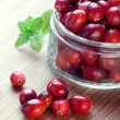 Cranberries in a glass jar — Stock Photo