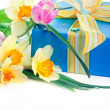Beautiful gift box with a bunch of spring flowers — Stock Photo