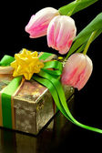Pink tulips and gift box on black background — Stock Photo