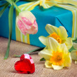 Valentine's day concept: red heart with gift box and flowers — Stock Photo