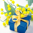Gift box with mimosa flowers - Stock Photo
