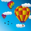 Vector hot air balloons in the sky - Stock Vector